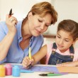 Grandmother Painting With Granddaughter — Stock Photo #59875433