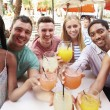 Friends Enjoying Drinks In Restaurant — Stock Photo #59875827