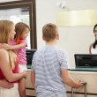 Family Checking In At Hotel — Stock Photo #59875947