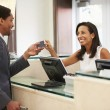 Businessman Checking In At Hotel — Stock Photo #59876725