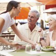 Waitress Serving Senior Couple Lunch — Stock Photo #59876759