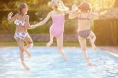 Girls Playing In Swimming Pool — Stock Photo