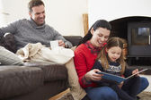 Family Relaxing And Reading Book — Foto de Stock