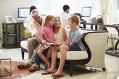 Grandparents With Grandchildren  In Hotel — Stock Photo