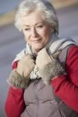 Senior Woman On Winter Beach — Stock Photo