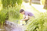Boy Fishing In Pond — Stock Photo