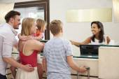 Family Checking In At Hotel — Stock Photo
