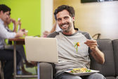 Man  Eating Lunch In Design Studio — Stock Photo