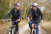 Senior Couple On Cycle Ride In Winter Countryside — Stock Photo