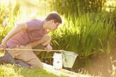 Boy Fishing In Pond — Stockfoto