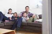 Family Relaxing Watching TV — Stock Photo