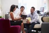 Three Businesspeople Having Meeting — Stock Photo