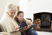 Grandmother And Granddaughter Reading Book — Stock Photo