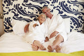 Senior Couple Relaxing In Hotel — Stock Photo