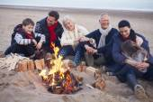 Multi Generation Family Sitting By Fire — Stock Photo