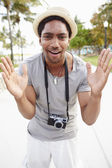 Young Man Carrying Camera — Stock Photo