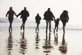 Family Walking On Winter Beach — Stock Photo