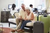 Senior Couple  Looking At Digital Tablet — Stock Photo
