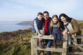 Family Walking Along Coastal Path — Stock Photo