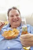 Man  Eating Chips And Drinking Beer — Stock Photo