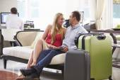 Couple Sitting In Hotel Lobby — Stock Photo