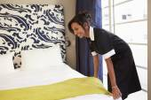 Maid Tidying Hotel Room — Stock Photo