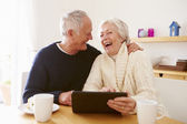 Senior Couple Using Digital Tablet — Stock Photo