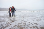 Father And Son  On Winter Beach — Stock Photo