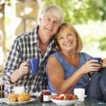 Senior couple eating — Stock Photo #61027681