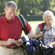 Couple on golf course — Stock Photo #61027961