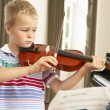 Young boy playing violin — Stock Photo #61028401