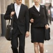 Businessman and businesswoman walking — Stock Photo #61028701