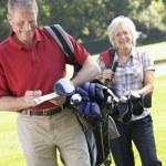Couple on golf course — Stock Photo #61028977