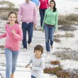 Family walking by sea — Stock Photo #61029085