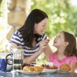 Mother and daughter eating breakfast — Stock Photo #61029399