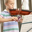 Young boy playing violin — Stock Photo #61029907