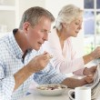 Couple eating breakfast — Stock Photo #61029921