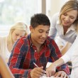 Students and tutor — Stock Photo #61029981