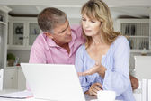 Mid age couple working  on laptop — Stock Photo
