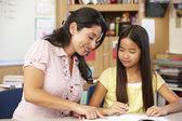 Teacher and schoolgirl — Stock Photo
