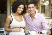 Expectant couple sitting in cafe — Stock Photo