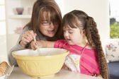 Girl with Downs Syndrome baking — Stock Photo