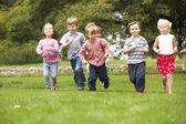 Children running in park — Stock Photo