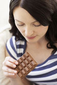 Woman eating chocolate — Stock Photo