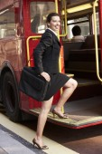 Businesswoman boarding bus — Stock Photo