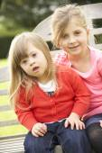 Girl with  Downs Syndrome sister — Stock Photo