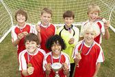 Winning junior soccer team — Stock Photo