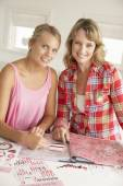 Mother and daughter scrapbooking — Stock Photo
