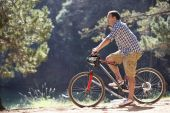 Man on bike ride — Stock Photo