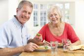 Retired couple enjoying meal — Stock Photo